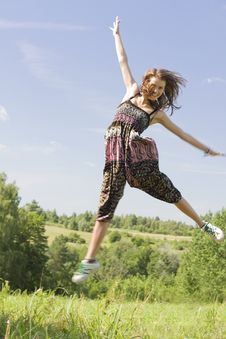 Free Young Happy Woman Jumping On A Green Meadow Stock Photography - 15987422