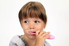 Free The Smiling Girl Brushes Teeth Royalty Free Stock Images - 15989459