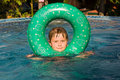 Free Child Enjoys Swimming With Rubber Ring Stock Photography - 15990442