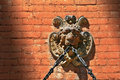Free Lion Face Gargoyle With Chain On Brick Wall Stock Image - 15994411