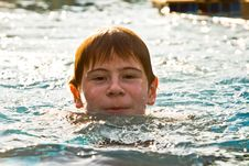 Boy With Red Hair Is Swimming In The Pool Stock Photo
