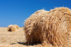 Free Wheat Haystacks With Blue Sky. Stock Image - 15991741