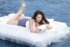 Free Woman Lying On The Bed In The Sea Royalty Free Stock Photography - 15992207