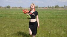 Free Young Woman With Bouquet Of Tulips In The Field. Stock Photos - 159982333