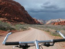 Free Bike Ride Into Desert Thunderstorm Stock Images - 166904