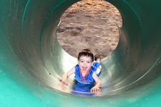 Free Boy Laughing And Playing With The Slide Royalty Free Stock Image - 167446