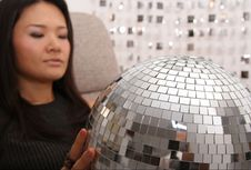 Free Japanese Woman Holds Glitterball Royalty Free Stock Photo - 1600785