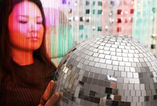 Free Japanese Woman Holds Glitterball Stock Photos - 1600793