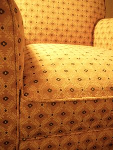 Free Yellow Patterned Overstuffed Chair Stock Photo - 1609000