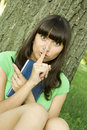 Free Female In A Park With A Notebook Stock Photo - 16003580