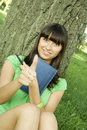 Free Female In A Park With A Notebook Royalty Free Stock Image - 16003646