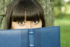 Free Female In A Park With A Notebook Stock Images - 16003544