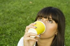 Free Female In A Park Drinking Coffee Royalty Free Stock Photo - 16003965