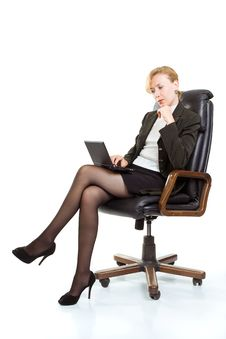 Free Business Woman With Laptop Sitting In A Chair Royalty Free Stock Photography - 16006017