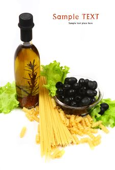 A Bottle Of Olive Oil With Pasta And Black Olives Royalty Free Stock Images