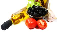 A Bottle Of Olive Oil With Pasta And Black Olives Royalty Free Stock Image