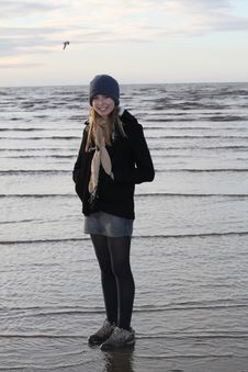 Pretty Teenage Girl On Beach In Winter Stock Images