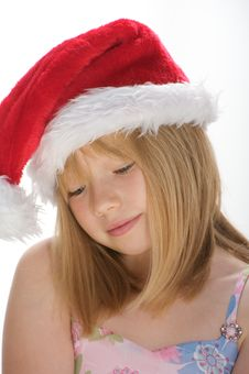 Free Young Girl In A Santa Hat Royalty Free Stock Photos - 16009268