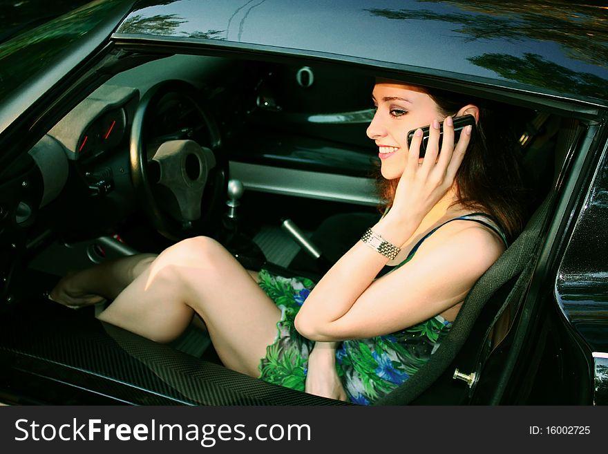 Beautiful girl is talking on telephone
