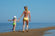 Mother With Child On The Beach Stock Images