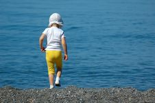 Free Child Walking On Seaside Royalty Free Stock Photography - 16012077