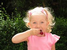 Little Girl Eats Cherry Royalty Free Stock Photos