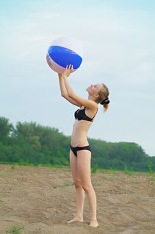 Girl With A Ball On The Beach Stock Image
