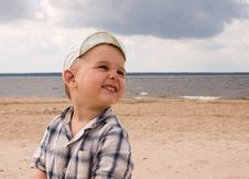 Smiling Boy On A Beach Stock Image