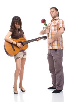 Free Girl With A Guitar And A Young Man With A Rose Stock Photos - 16014543
