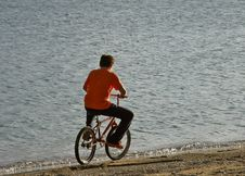 Free Boy Riding A Bicycle On A Beach Royalty Free Stock Images - 16018829