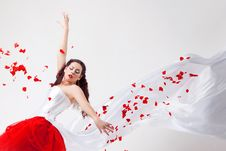 Free Young Beautiful Woman With Petals Of Roses Royalty Free Stock Photography - 16019717