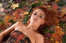 Free Autumn Image With A Girl Lying In Fallen Leaves Royalty Free Stock Photography - 16019877