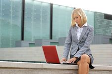 A Young Business Woman Working With A Laptop Royalty Free Stock Photography