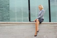 Free A Young Blond Businesswoman In Formal Clothes Royalty Free Stock Images - 16020069