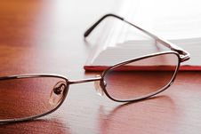 Free Glasses Close-up And Open Book Royalty Free Stock Photography - 16021007