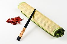 Chop Sticks And Some Chili Fruits Royalty Free Stock Photography