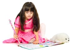 Little Girl With Pencil Lying On Floor. Isolated Stock Images