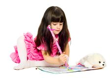 Little Girl With Pencil Lying On Floor. Isolated Stock Photos