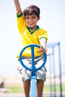 Free Young Kid Enjoying Swing Ride Stock Photography - 16027052