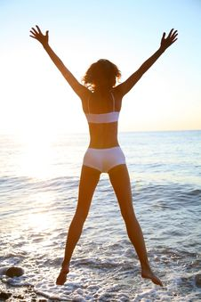 Free Girl Is Happy On The Beach Royalty Free Stock Photo - 16030135