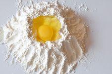 Free The Broken Egg Is In A Flour Stock Photos - 16031703