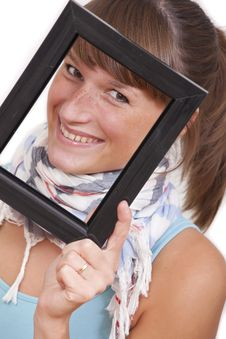 Woman Looking Through Photo Frame Royalty Free Stock Image