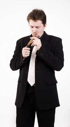Free Man Smokes Cigar Stock Photos - 16036093