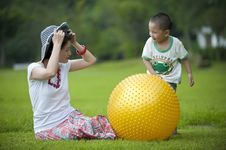 Free Mother And Son Play Ball In Grass Royalty Free Stock Images - 16038419