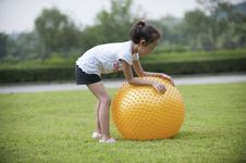 Free Asian Girl Play Ball In The Grass Royalty Free Stock Photo - 16038735