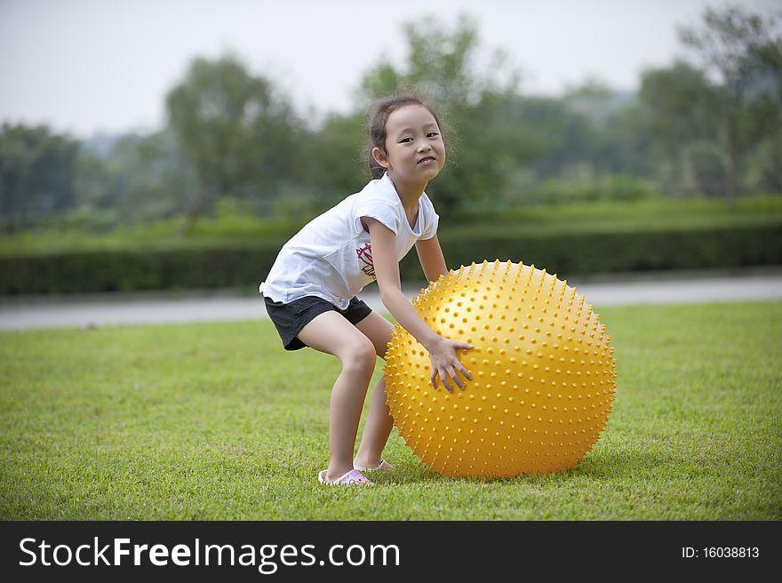 Asian girl play ball
