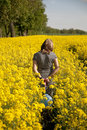 Free Girl On Canola Field Stock Photos - 16049413