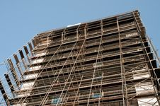 Free Building Under Construction In Scaffolding Royalty Free Stock Photos - 16042208