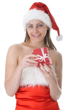 Beauty Woman In  Santa Hat With Present Royalty Free Stock Photography