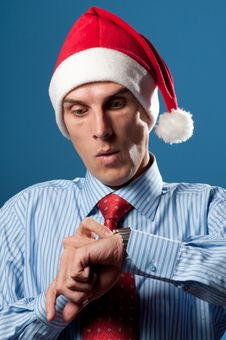 Free Man In Red Christmas Hat Royalty Free Stock Image - 16044516